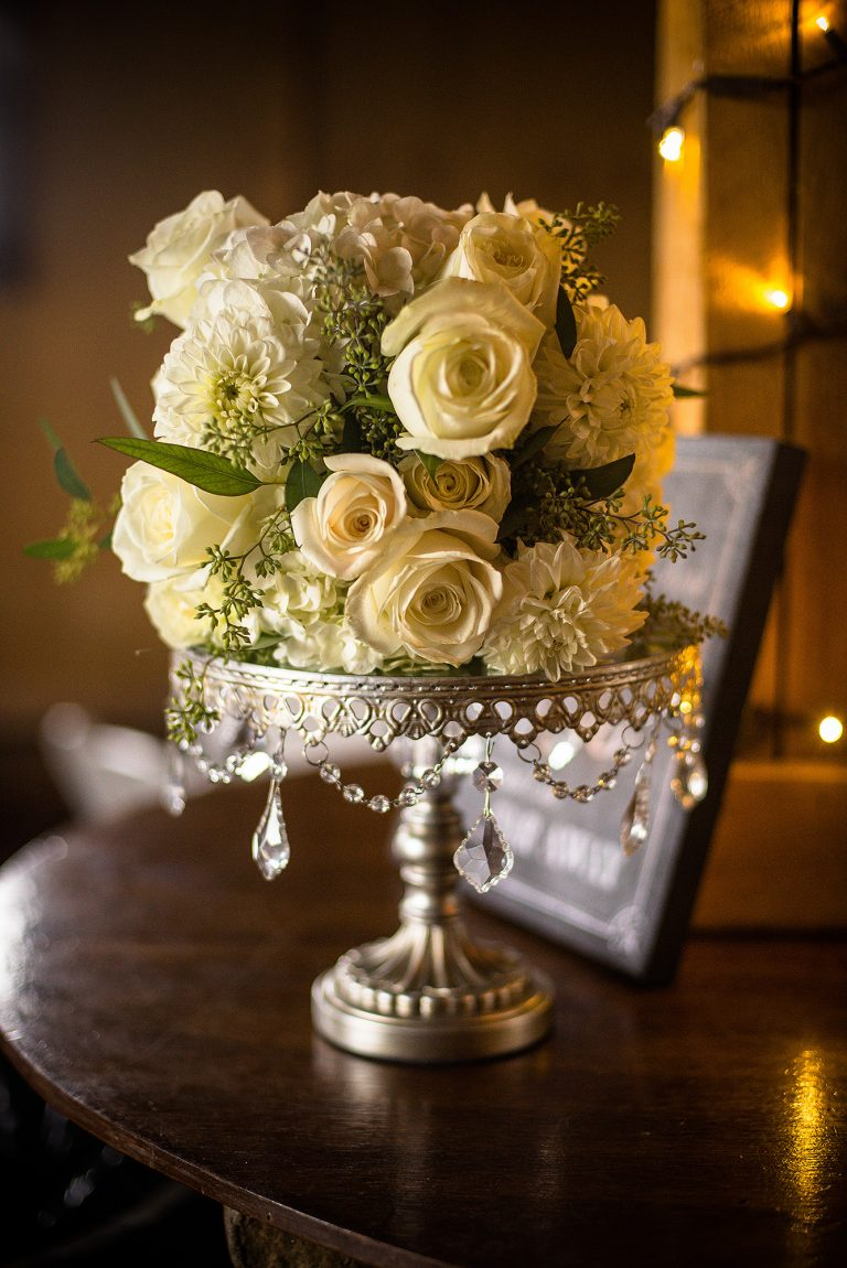 elegant cake display with white roses