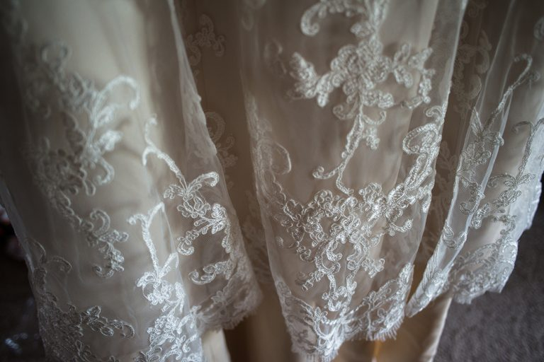 close up detail of the lace on a bridal dress