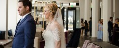Bride and groom doing a first look in the lobby at the Hotel Covington in Covington, Kentucky