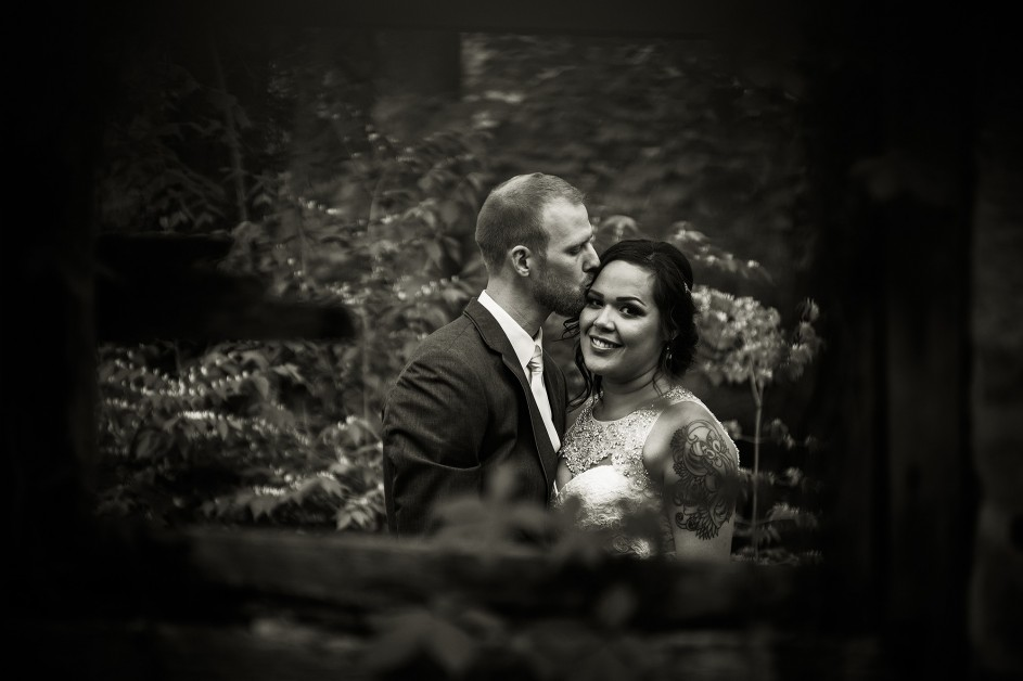 moody black and white photo of bride and groom in abandoned brick home at Ohio Barn Fairborn Ohio