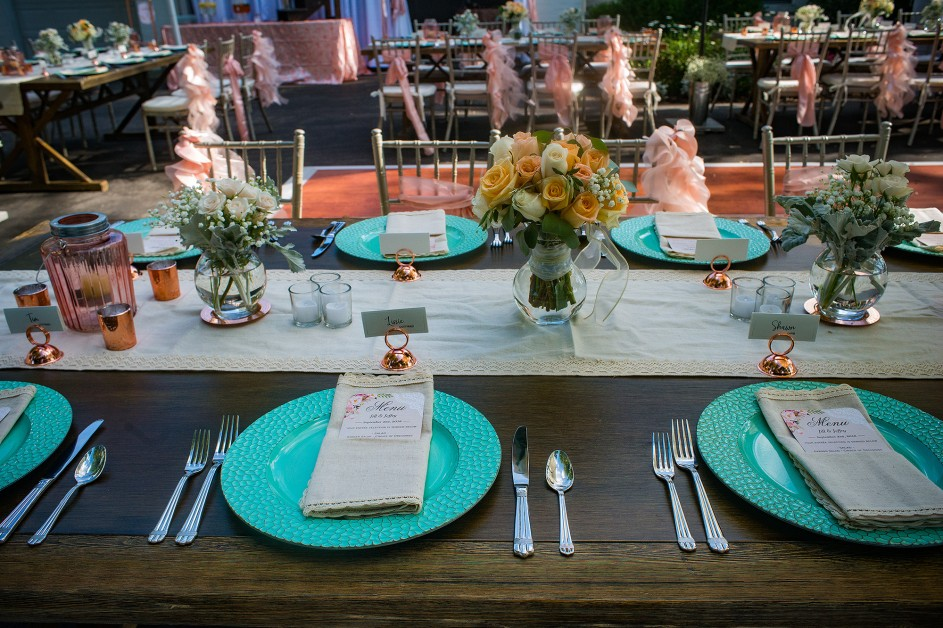 elegant turquoise plates and dinner setting for an outdoor wedding